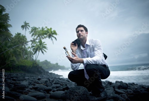 Businessman with Message in a Bottle