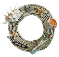 Round frame of rope with seashells, starfish and bottle