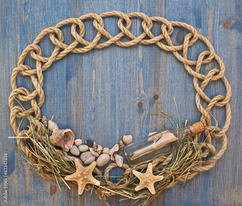 Sea frame with rope, shells and bottle