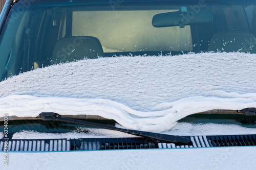 Vehicle windshield fresh snow thawing