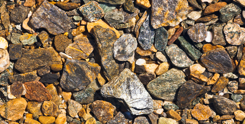 Rough gravel geologic natural background pattern