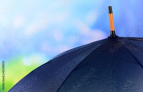 Blue Umbrella on bright background