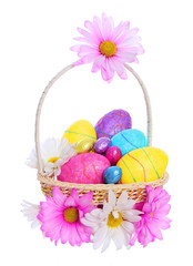 Easter Basket with Colorful Eggs and Chamomile Flowers isolated