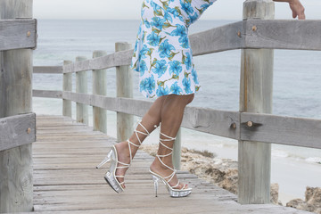 Pretty legs in high heels relaxed at beach