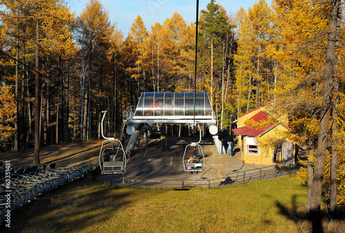 Landing place on chair lift in autumn mountain forest