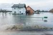 Leinwandbild Motiv House surrounded with water