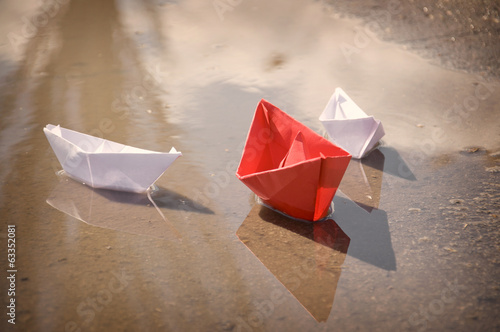 White red paper boats floating water spring