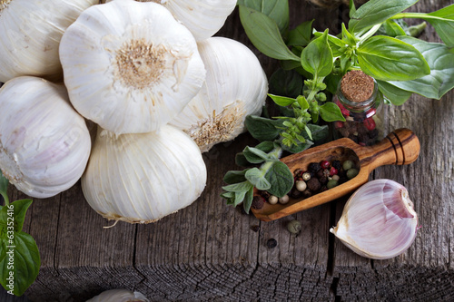 Garlic heads on a wooden table