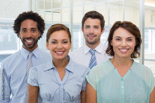 Smiling young business people in office