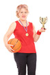 Mature woman holding trophy and a basketball