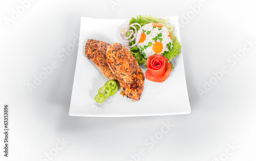 Grilled steak on plate isolated on white