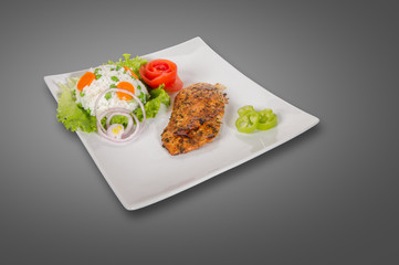 Chicken fillet on plate isolated on gray background