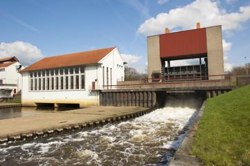 Weir with running water spill