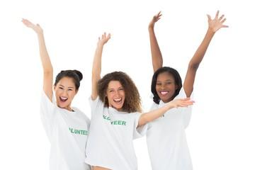 Attractive team of volunteers waving at camera