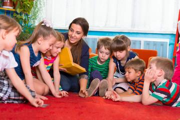 Reading to children at kindergarten