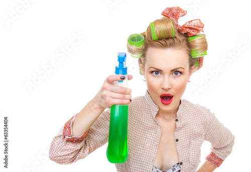 Funny housewife / woman spraying the cleaner
