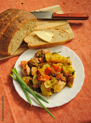stewed potatoes with sausages and vegetables