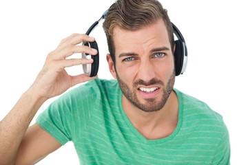 Portrait of a irritated young man with headphones