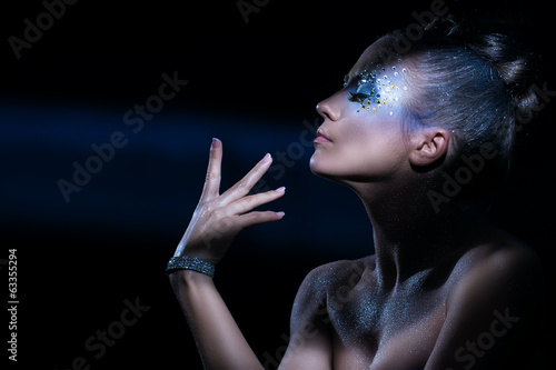 Attractive woman with artistic make-up