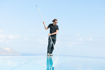 Cleaning of a big infinity pool.