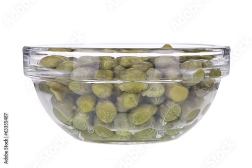 Green capers in a glass bowl.