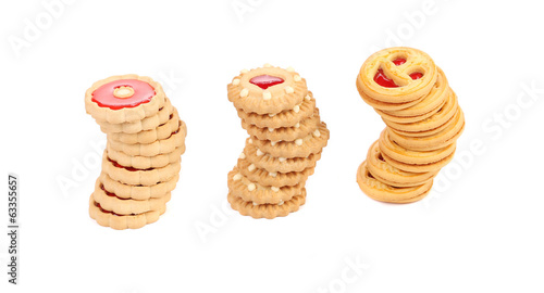 Three stacks of different biscuits.