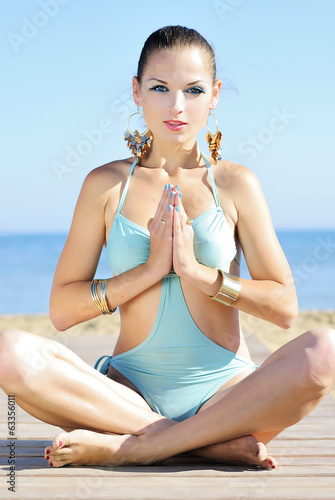 Graceful girl ashore epidemic deathes concerns with yoga