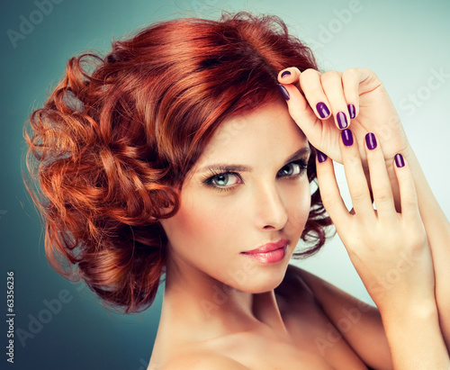 Leinwandbild Motiv Model with curled red hair