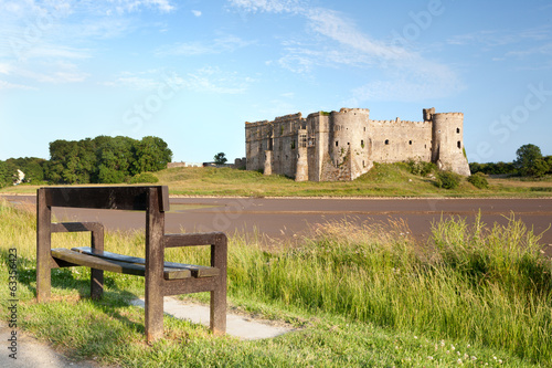 Empty bench facing Carew Castle, Pembrokeshire, Wales