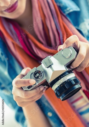 Young smiling woman looking at her camera