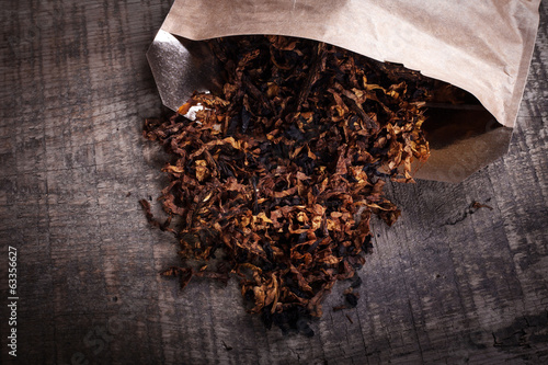 opened package of tobacco on  wooden surface