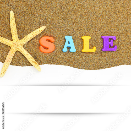 Sale text and starfish with banner on sand