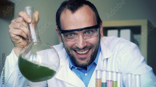 Crazy, mad scientist laughing in laboratory, super slow motion