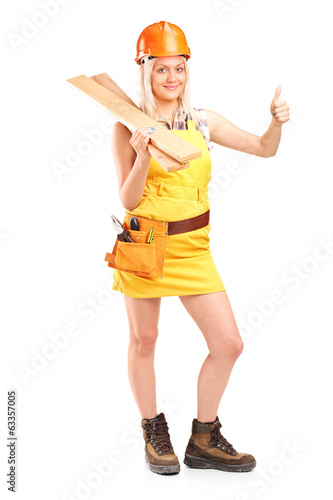 Female carpenter giving thumb up