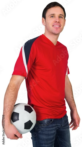 Football fan in red holding ball