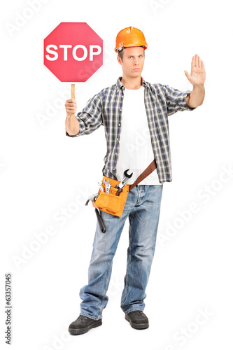 Construction worker holding a stop sign