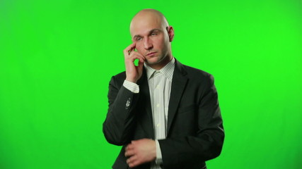 Portrait of a thinking businessman against a green screen