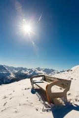 Bench in ski resort Bad Gastein in winter  mountains, Austria
