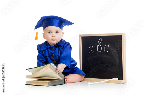 Baby in academician clothes  with book and chalkboard