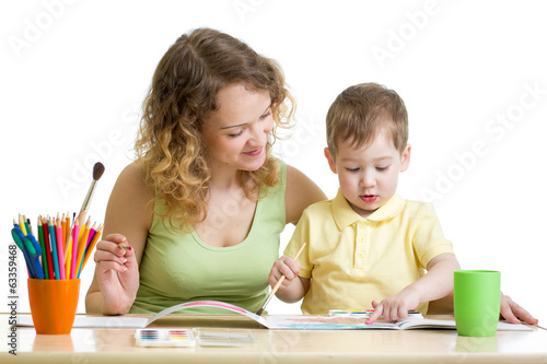 mother and kid boy paint together