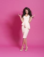 Fashion model posing on pink background