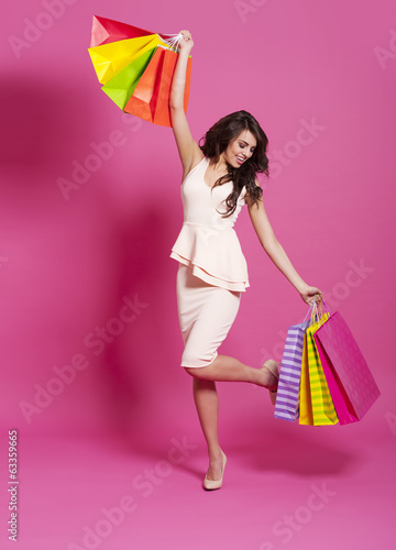 Excited fashion woman with shopping bags