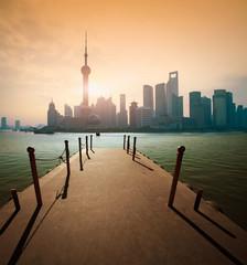 Shanghai skyline at sunrise wharf
