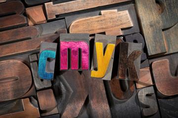 cmyk written with antique letterpress type
