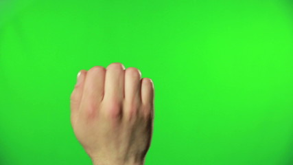Hand knocking on the green screen