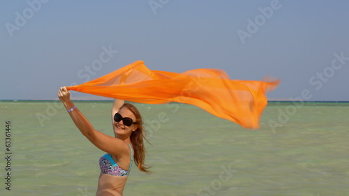 Young woman with pareo on the beach