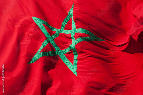 Waving National flag of Morocco. Green star on red background