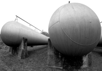 huge oblong tanks in industrial plant outside of the factory