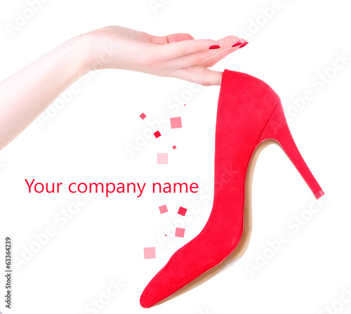 Woman hand holding beautiful red female shoe, isolated on white