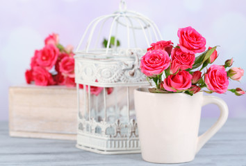 Beautiful small pink roses, on light background